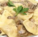 Ravioli with ham and cheese in a mushroom sauce